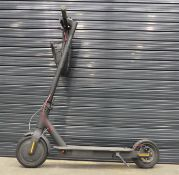 Grey electric scooter with charger