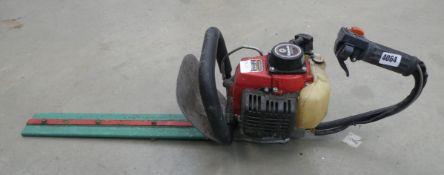 Kawasaki red petrol powered hedge cutter