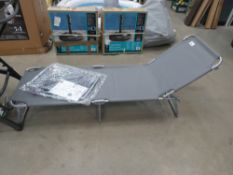 Grey garden recliner on grey tubular frame