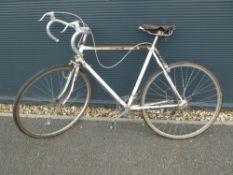 White and rust racing bike