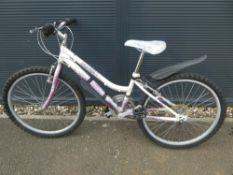 White and pink girls bike