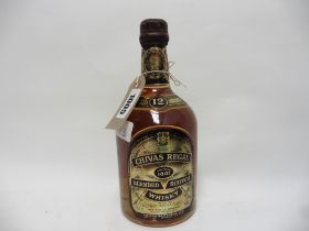A bottle of Chivas Regal 12 year old Blended Whisky circa mid 1970's, 26 2/3 fl oz / 75.