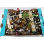 A collection of over 80 assorted miniatures including 12 various whisky