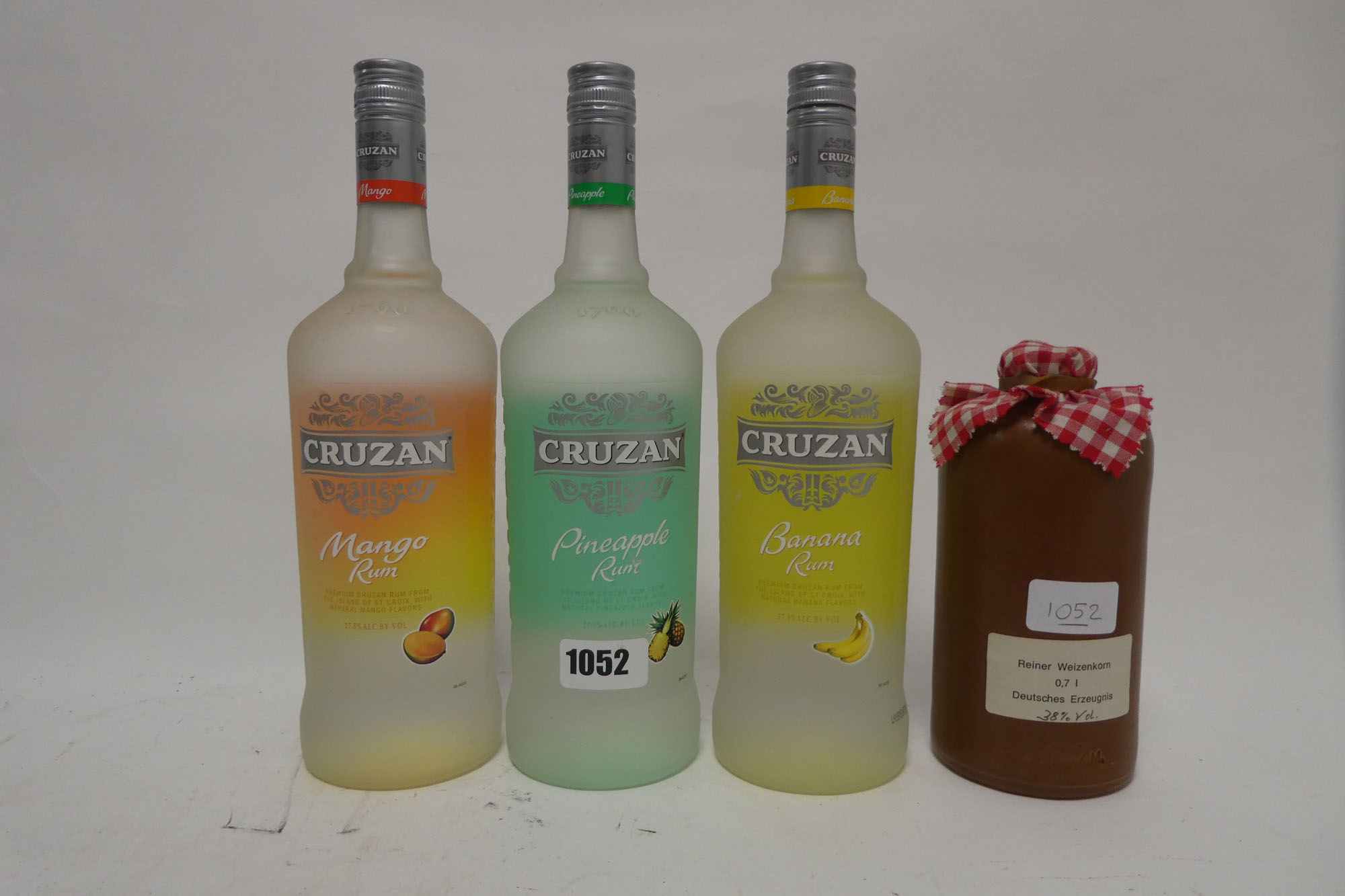 4 bottles, a set of 3 Cruzan flavoured White Rums, Mango, Banana & Pineapple 1 litre 27.5% each &