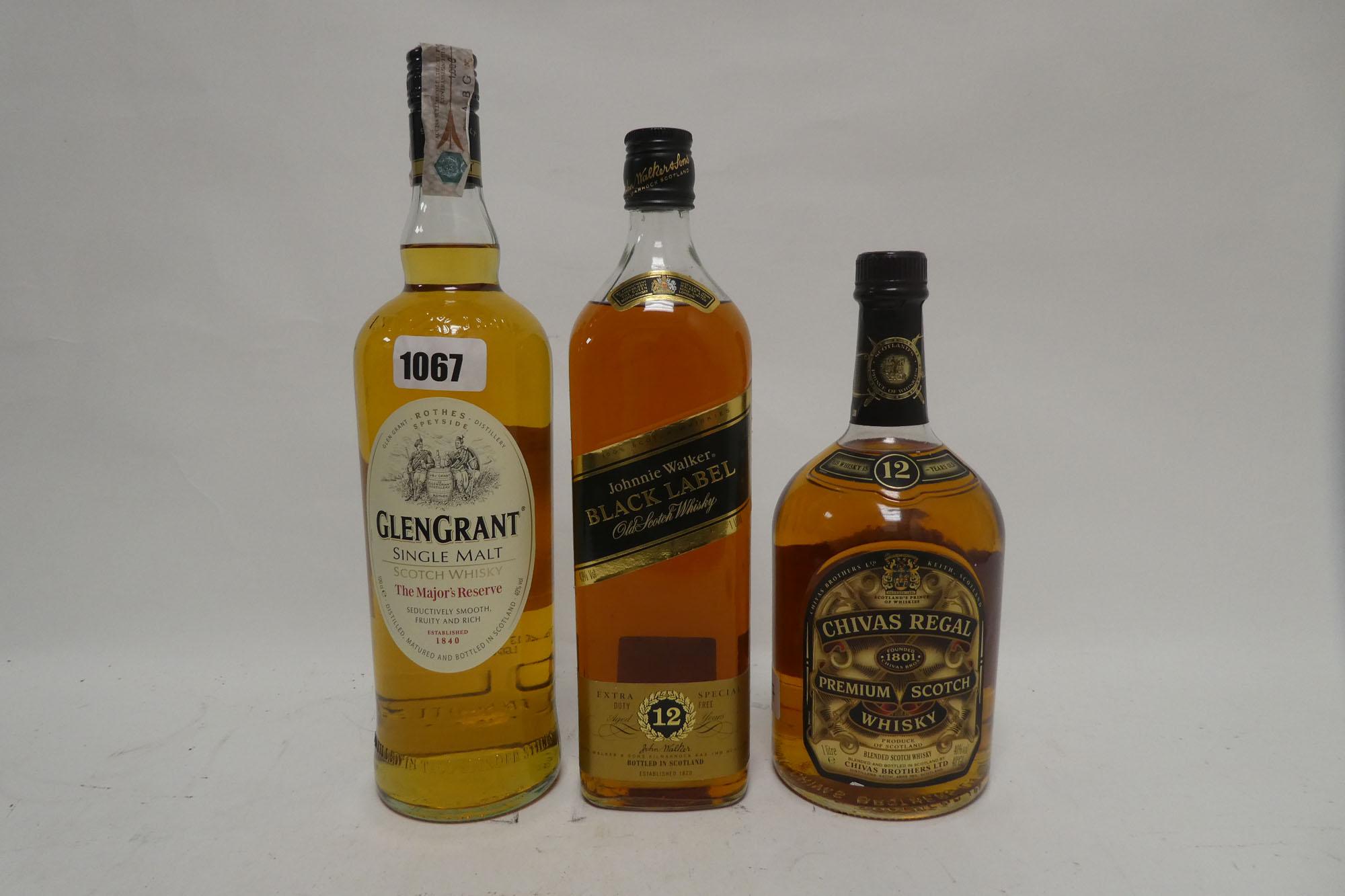 3 bottles, 1x Johnnie Walker Black Label 12 year old Scotch Whisky Duty Free label 1 Litre 43%, 1x
