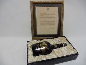 A limited Edition Courvoisier Chateau Limoges ceramic decanter of Fine Champagne Cognac with part