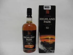 An old bottle of Highland Park 12 year old Single Malt Scotch Whisky from the Orkney Islands with