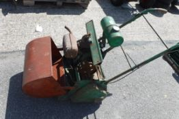 Vintage lawn mower with roller attachment and grass box