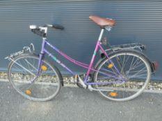 Pink and purple ladies bike