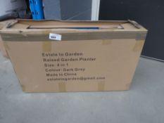 Box containing a metal flatpack garden planter
