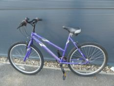 Purple and white Universal girls mountain bike