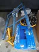 Quarter underbay containing wallpaper stripper, axle stands, log stand and some tool belts