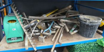 Large bay of assorted tools including hoes, shovels, forks, pickaxes, rakes, hosepipe, hosereel