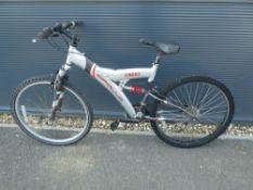 Silver and red Apollo suspension mountain bike