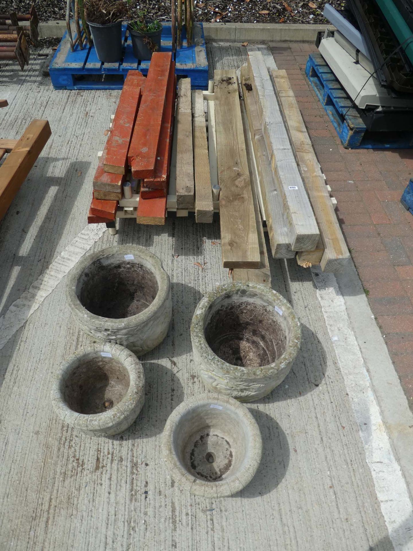 Quantity of plastic stands and assorted pieces of timber