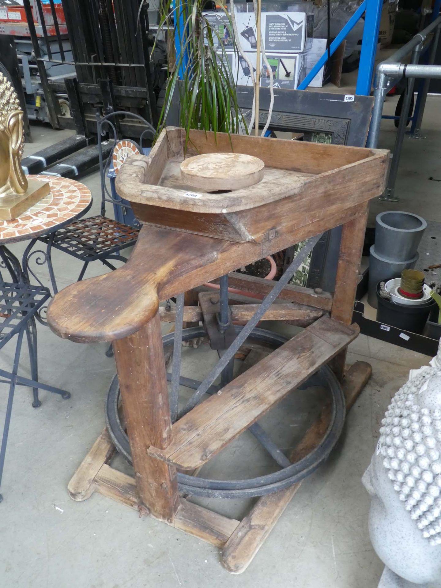 Vintage manual wooden potter's wheel