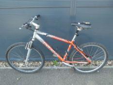 Saracen silver and orange mountain bike