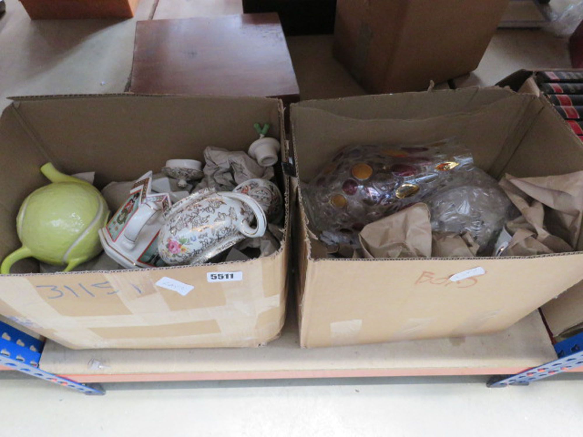 2 boxes containing quantity of floral patterned crockery, novelty tennis ball, teapots, plus