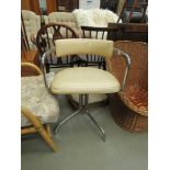 Cream leather effect and chrome swivel armchair