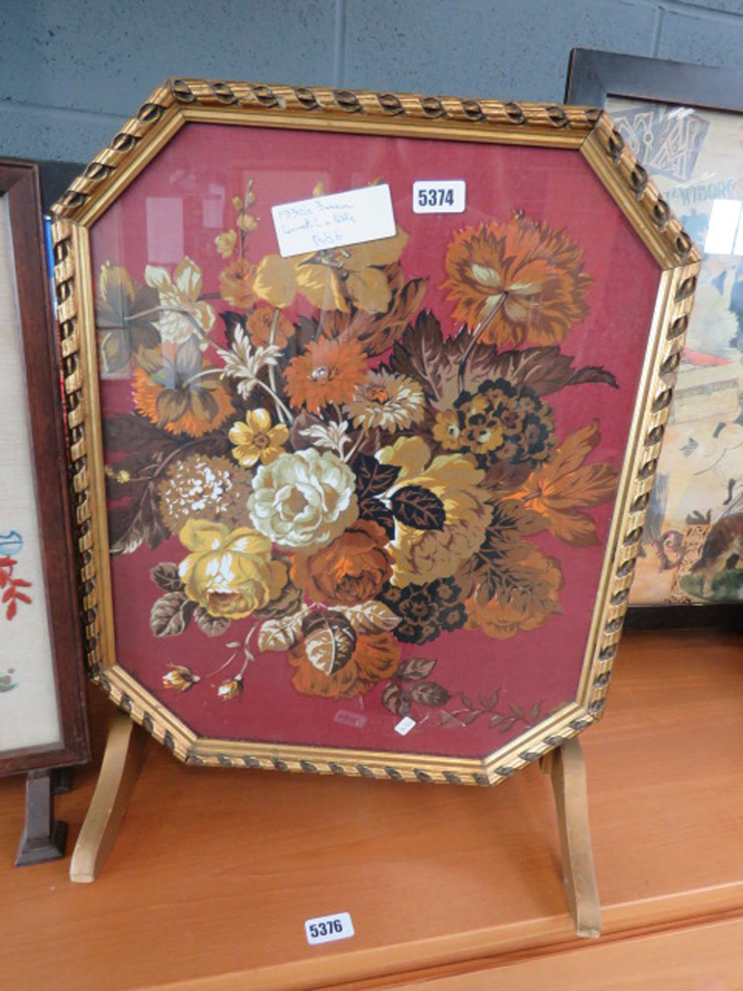Firescreen with floral tilting panel