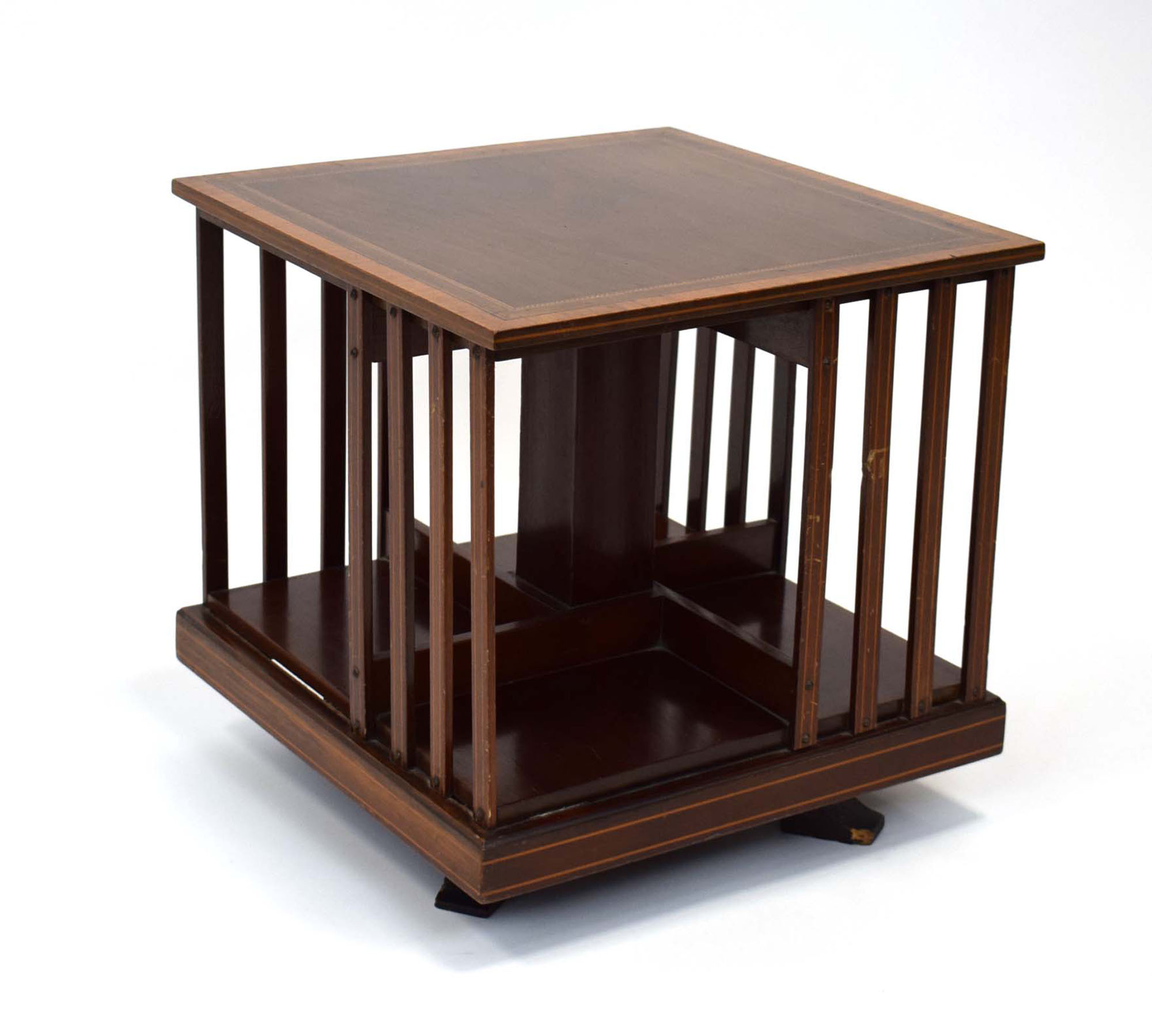 21 (4/6) An Edwardian mahogany, strung and inlaid revolving bookcase of small proportions, 55 cm