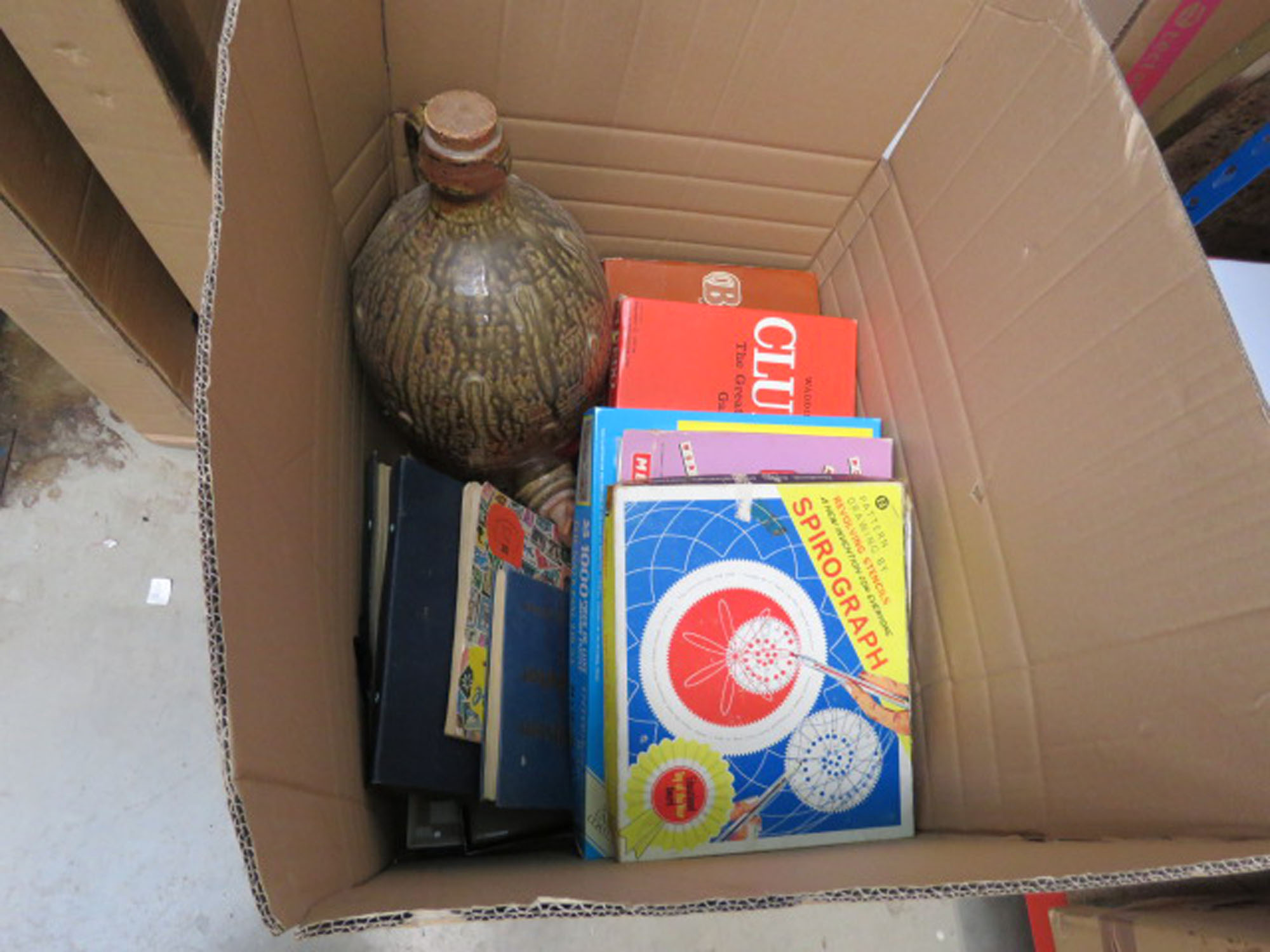 Box of boar games, stamp albums and pottery keg