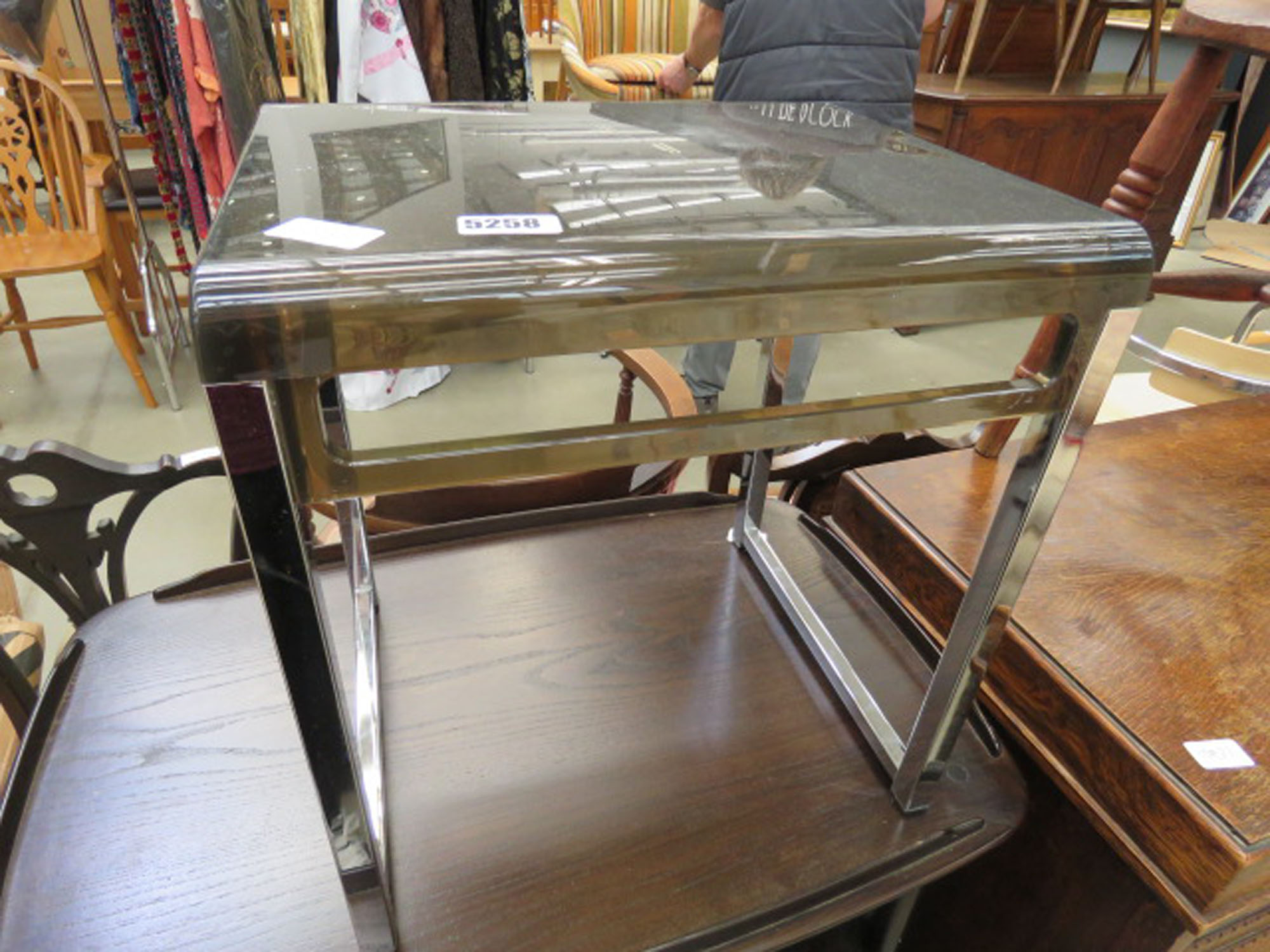 Bent plastic and chrome side table