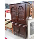 5148 pair of brown painted storage cabinets with wicker panels