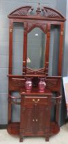 Dark wood hall stand with central mirror