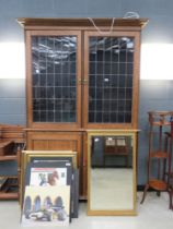 oak double door bookcase with cupboard base with glazed and leaded panels