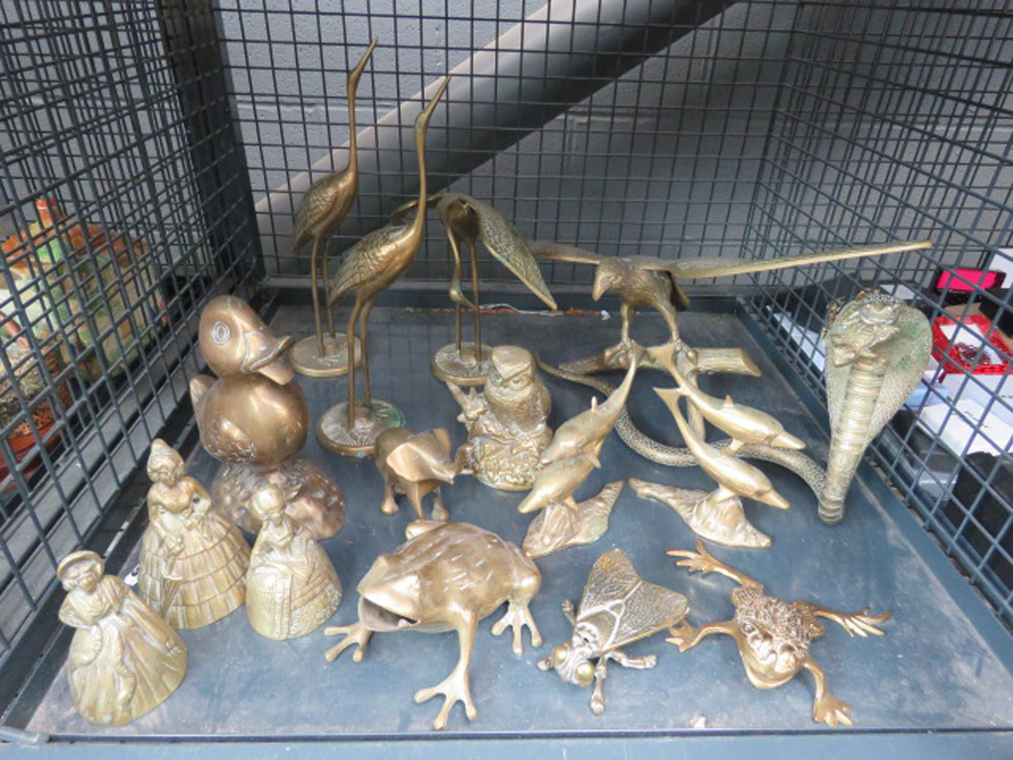 cage containing ornamental brass figures
