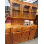 Pine dresser with glazed doors