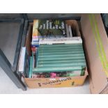 Box containing Readers Digest reference books