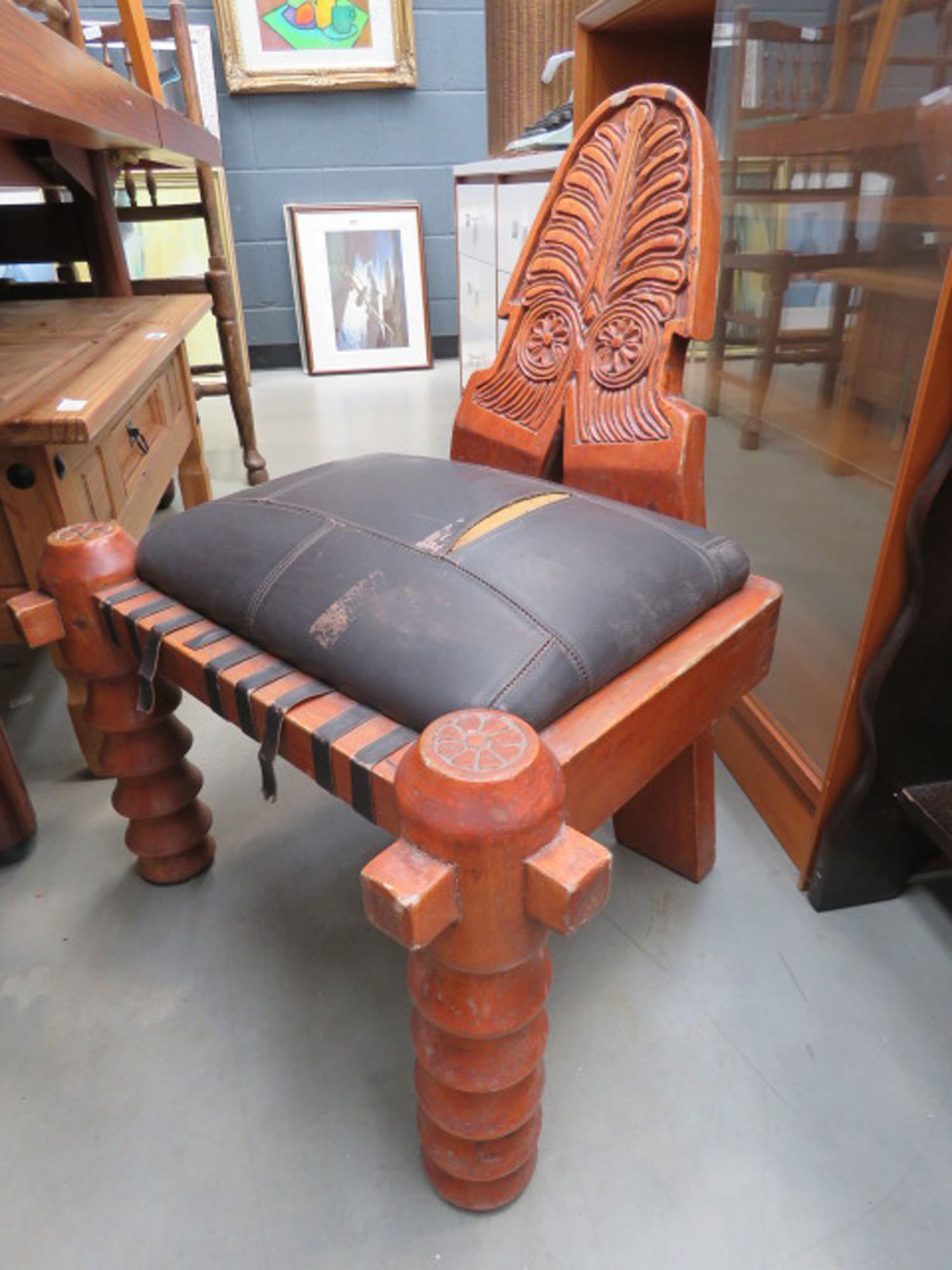 Carved chair with leather effect seats