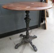 Circular pub table on cast iron base