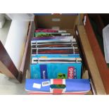 Box containing GCSE Geography and English text books