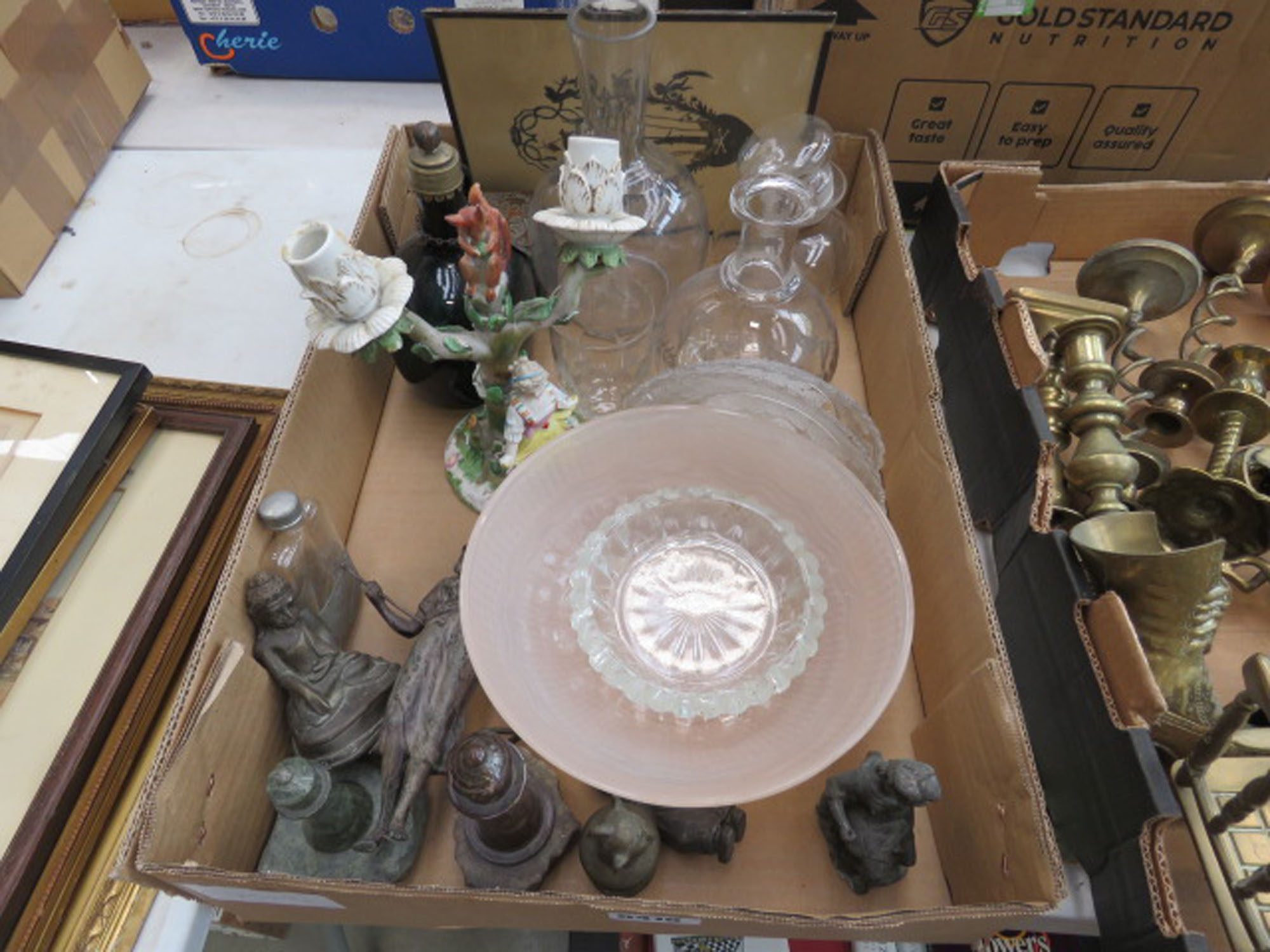 Box containing ornate 2 branch candlestick, family crest, coloured glass, copper pot, Spelter