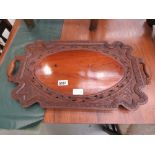 Carved wooden serving tray