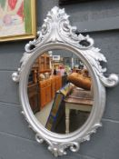 Oval mirror in silver painted frame