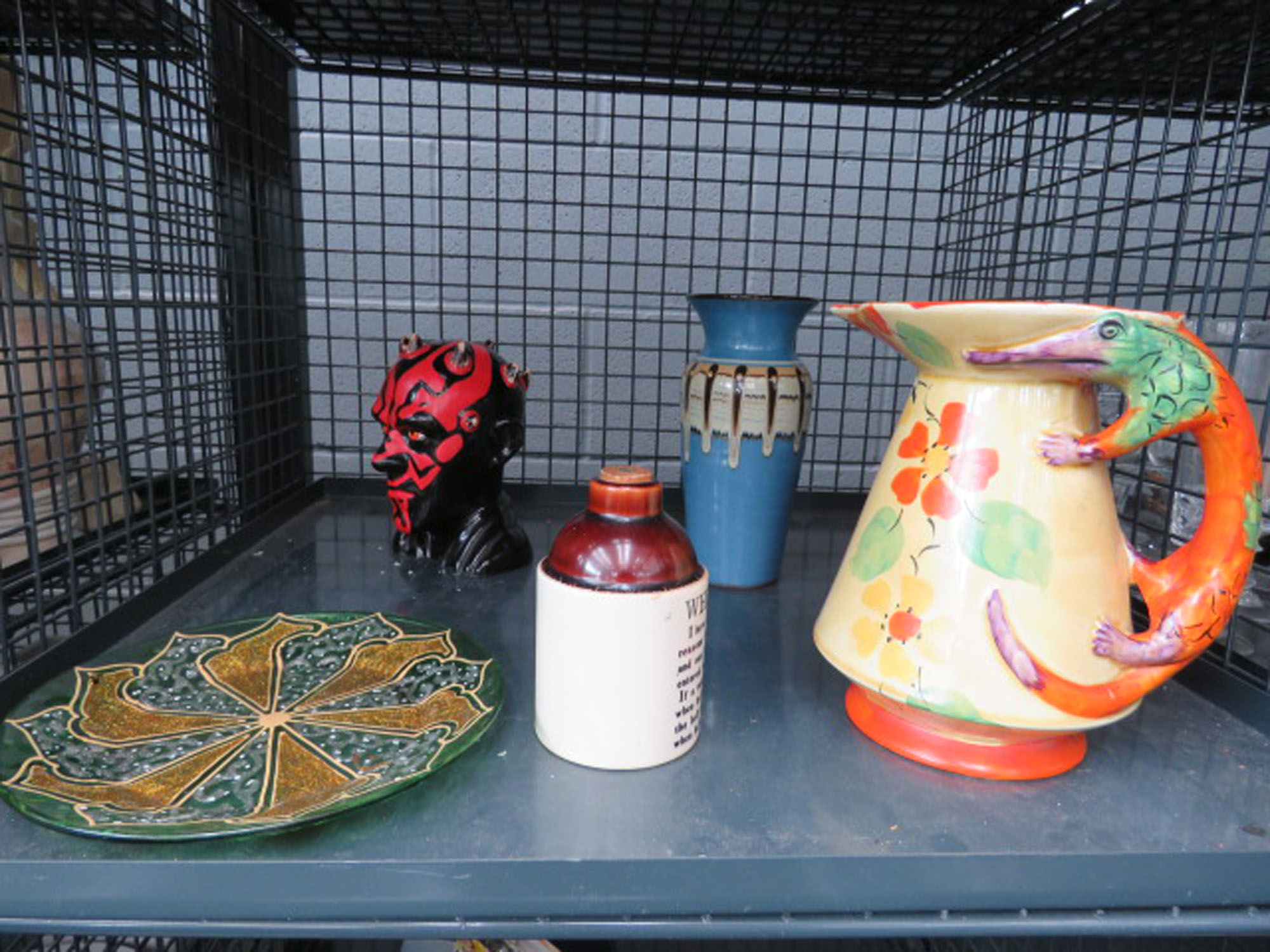 Cage containing 1930's painted jug, studio pottery vase, small whisky bottle, glassware and figure