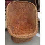 Low slung wicker easy chair