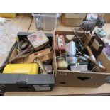 2 boxes containing brassware, ornamental anchors, vintage radio, lion winders, games and general