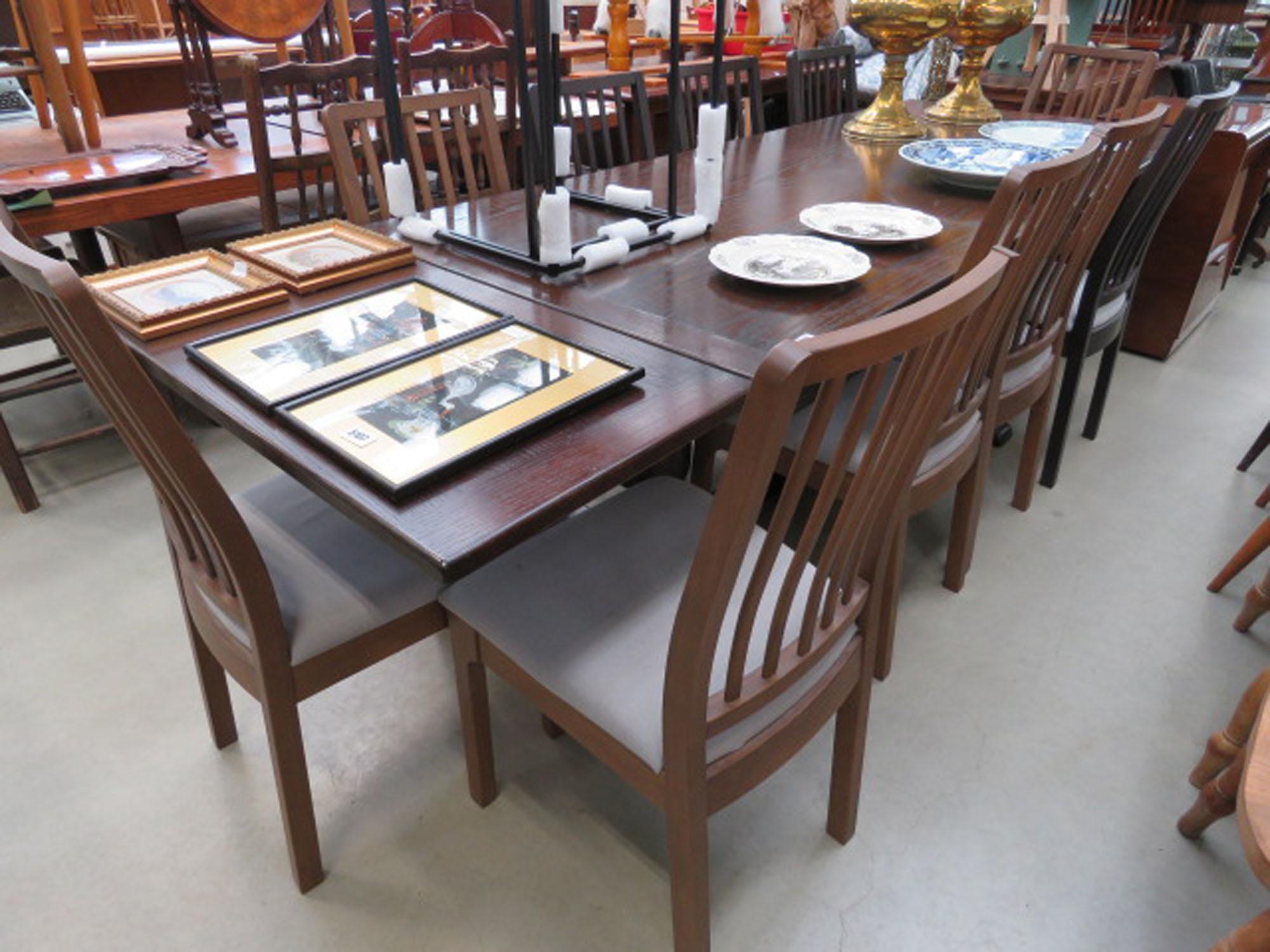 Dark oak drawerleaf table plus 10 chairs