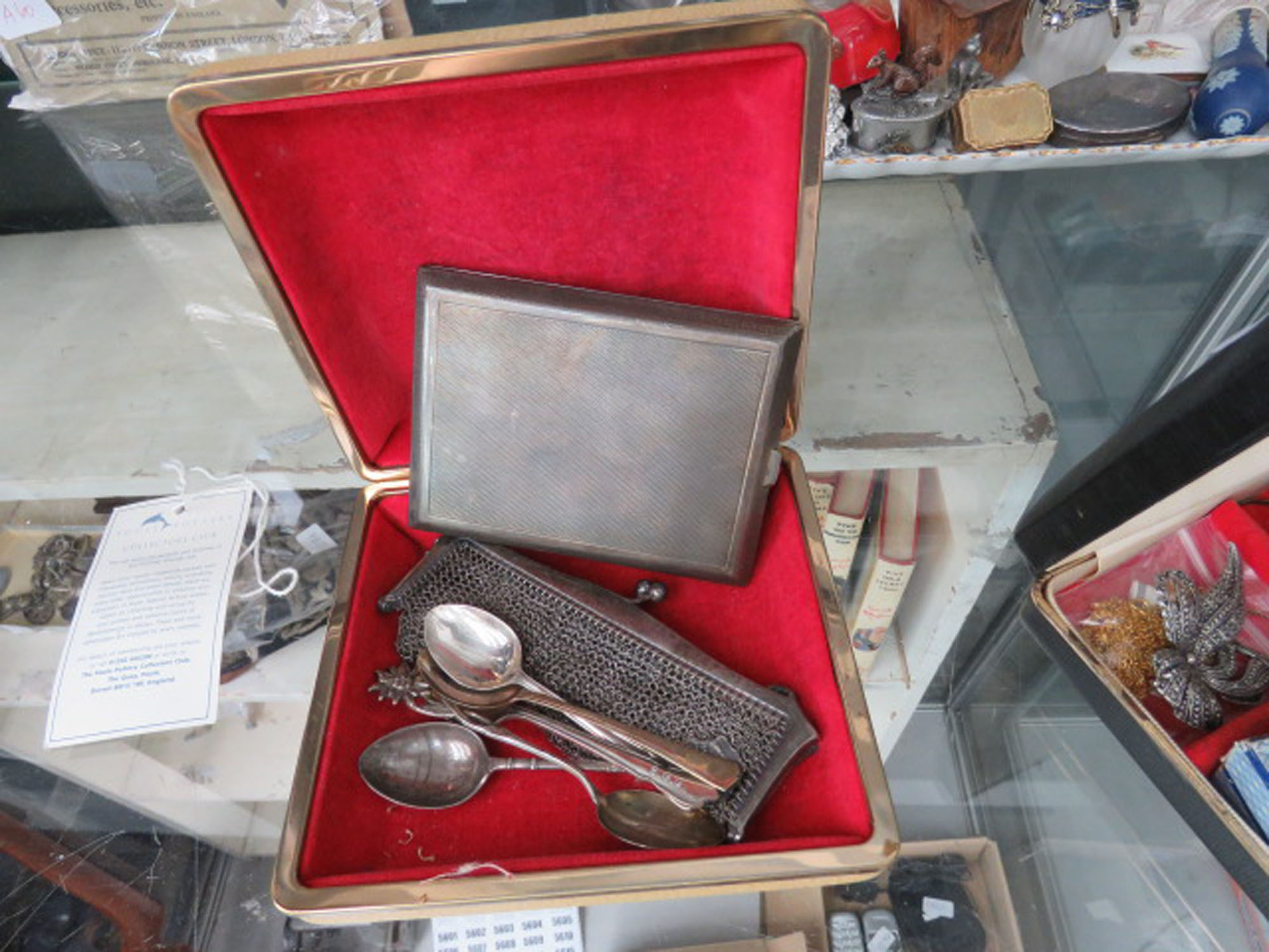 (2) Box containing silver cigarette case, loose teaspoons and mesh purse