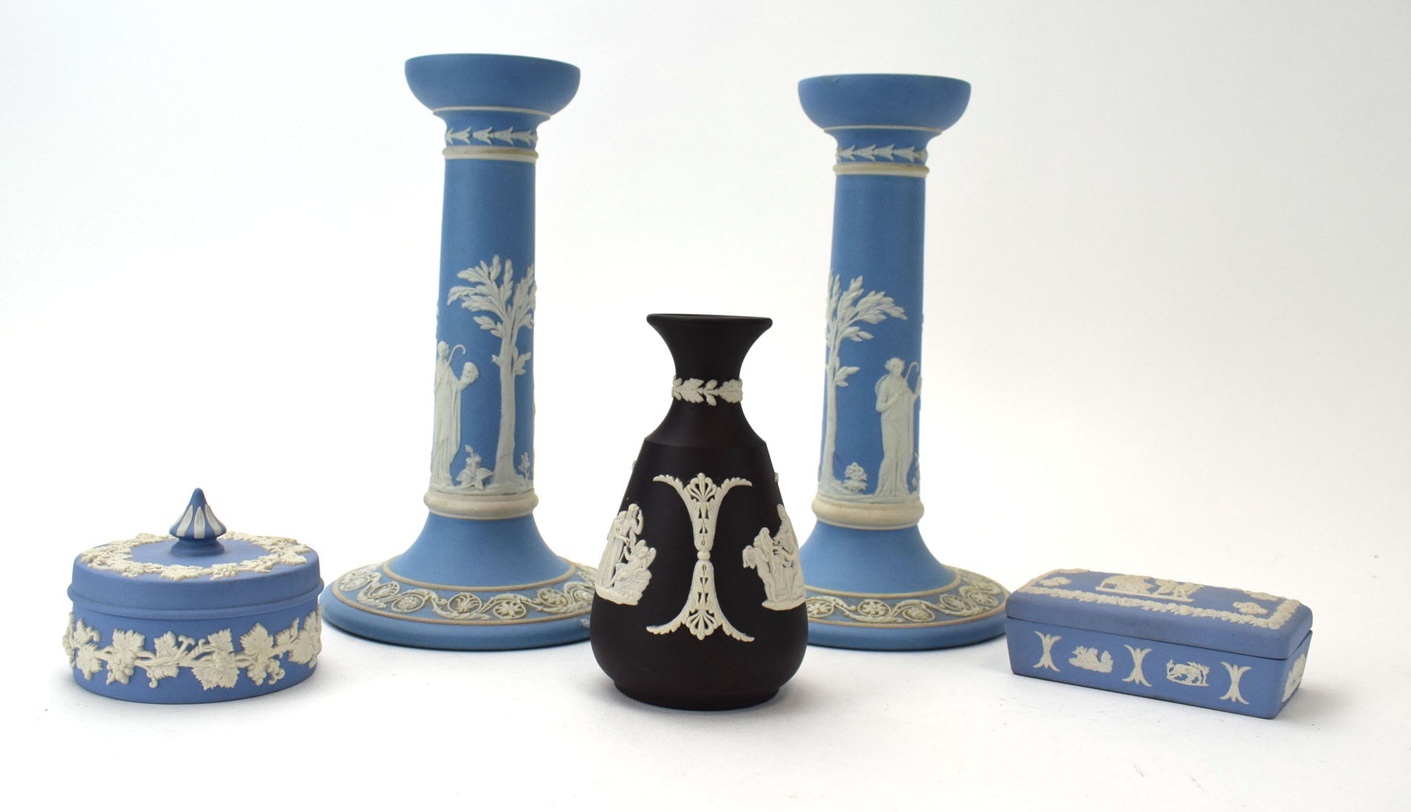 RR 411 - A pair of Wedgwood jasperware candlesticks typically decorated in the Neo-Classical manner,