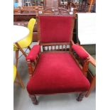 Carved Edwardian armchair with maroon fabric