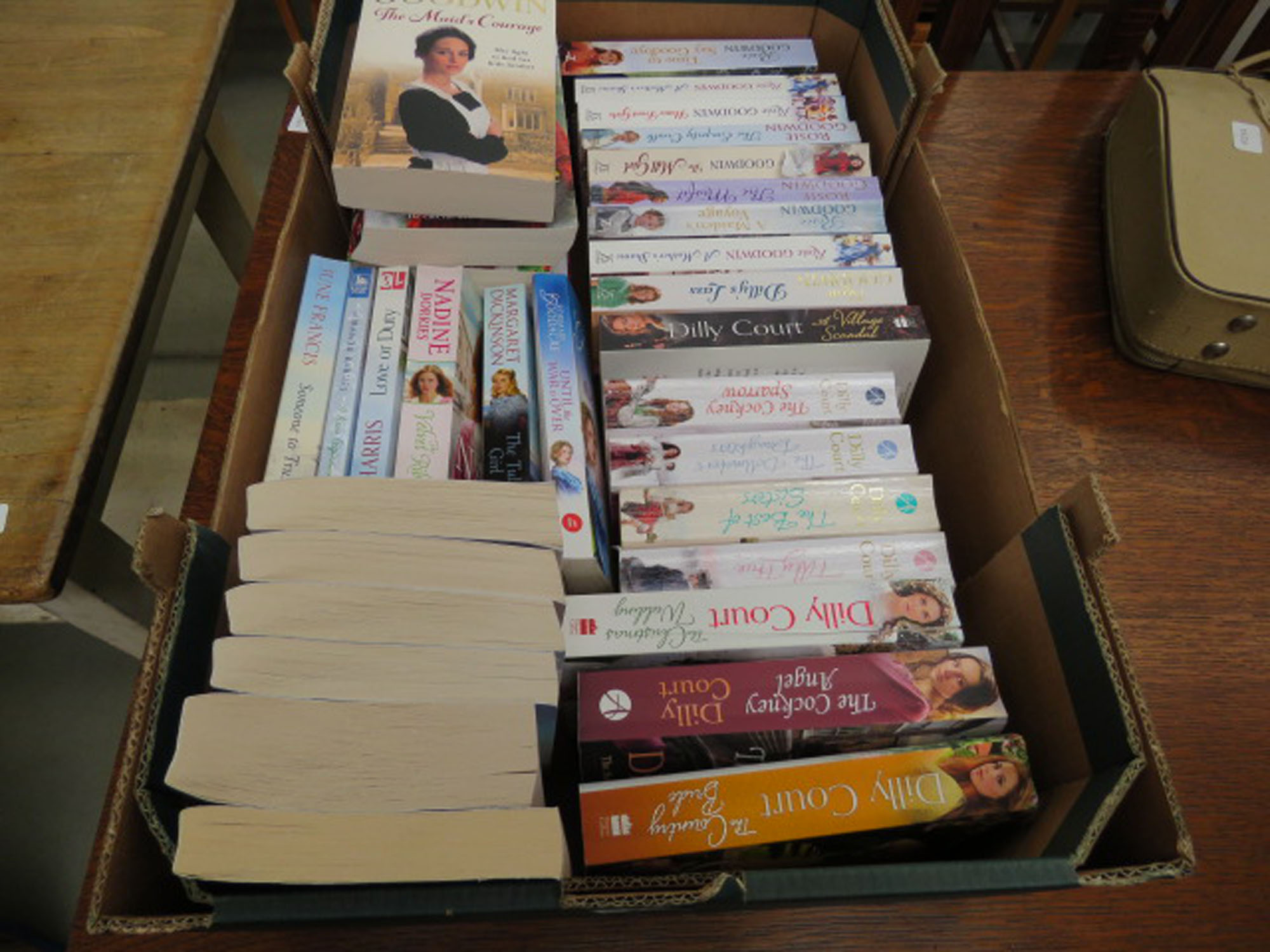 Box containing Rosie Goodwin, Dilly Court and other romantic novels