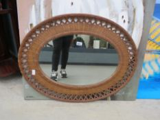 Oval mirror in rattan frame