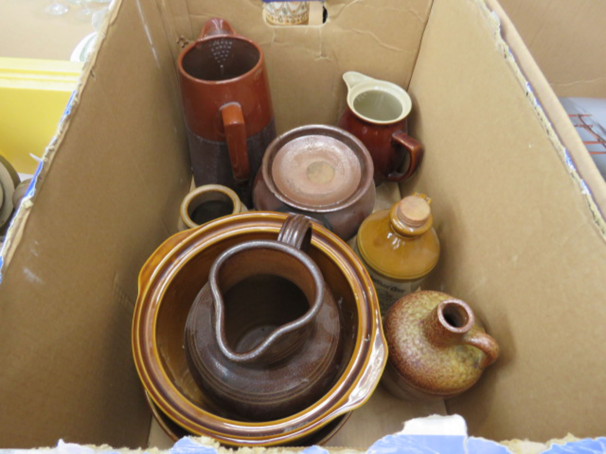 Box containing pottery jugs and storage vessels