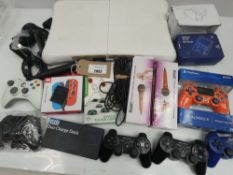 Bag containing gaming accessories; Wii board, PS3 and Xbox controllers, retro handheld console, VR